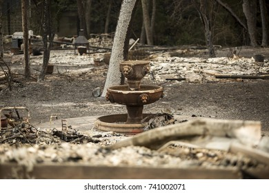 GLEN ELLEN, CALIFORNIA/ USA - OCT 16, 2017: A fountain near the remains of a home in a Sonoma County Neighborhood. Fires in California have burned over 220,000 acres and destroyed 5700 structures.