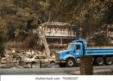 GLEN ELLEN, CALIFORNIA/ USA - OCT 16, 2017: A PG&E truck drives through a devastated Sonoma County neighborhood. Fires in California have burned over 220,000 acres and destroyed 5700 structures.