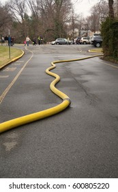 GLEN ROCK, NEW JERSEY - MARCH 7, 2017: Firehose at location of emergency. Editorial use only.