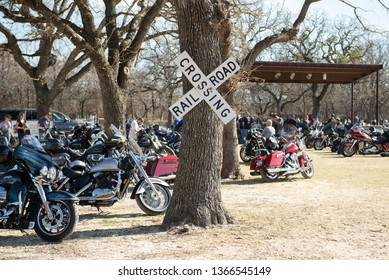 Glen Rose, Texas / USA February 11 2017 Image of Motorcycles and Biker People at Loco Coyote Bar and Grill In Glen Rose Texas on a Sunny Day