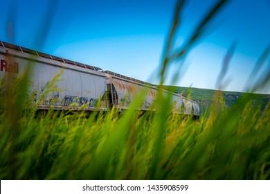 Glenbow, Alberta / Canada - 06 22 2019: A CP Rail cargo train passing through Glenbow Ranch Provincial Park