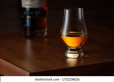 Glencairn whisky on wooden brown table with bottle