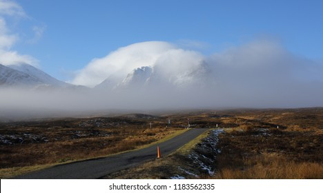 Glencoe, at the junction to Kings House Hotel on the A82 with the snow covered hills enveloped in cloud.