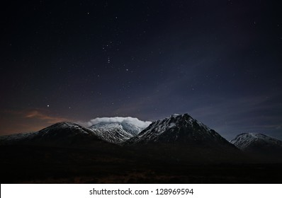 Glencoe Star-scape with the snow capped Black mount mountain range. Stars in this image include: Sirius, the brightest star in the night sky, and the constellation of Orion