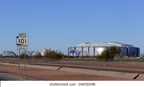 GLENDALE, AZ - JANUARY 24, 2015: One week before Super Bowl XLIX, highway sign Loop 101 near University of Phoenix Cardinal Stadium where New England Patriots play Seattle Seahawks on February 1 2015
