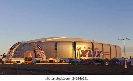 GLENDALE, AZ - JANUARY 24, 2015: Gold evening color cast on silver dome of University of Phoenix Arizona Cardinal Stadium that dressed up for Super Bowl XLIX taking place on  February 1, 2015