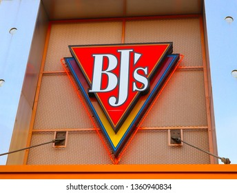 Glendale, California, United States – April 6, 2019:  BJ's sign. Bj's restaurant and brewhouse outdoor name. Company logo on entrance view at day. BJ's exterior company name.