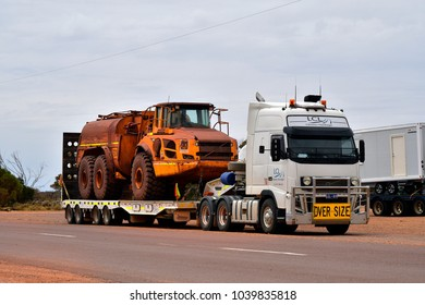 GLENDAMBO, SA, AUSTRALIA - NOVEMBER12: Truck with oversize mining vehicle on trailer on Stuart highway in South Australia, on November 12, 2017 in Glendambo, Australia