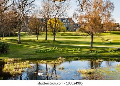 GLENEAGLES, SCOTLAND - APRIL 18, 2014: View of the garden and pond at Gleneagles Hotel.
