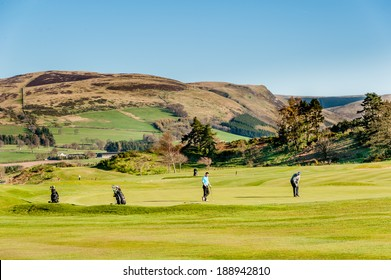 GLENEAGLES, SCOTLAND - APRIL 18, 2014:  View of golfers on the green of the King's Course at Gleneagles.