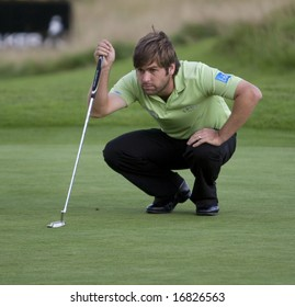 GLENEAGLES SCOTLAND AUGUST 28, England's Robert Rock lines up a putt on the 18th whilst competing in the Johnnie Walker Classic PGA European Tour golf tournament at Gleneagles Perthshire Scotland