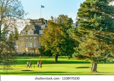 GLENEAGLES, SCOTLAND - AUGUST 30, 2016: A group of four people playing golf close to the Gleneagles Hotel in Perthshire, Scotland.