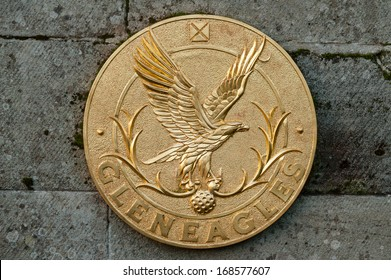 GLENEAGLES, SCOTLAND - DECEMBER 17, 2013:  A gold colored crest at entrance to the Gleneagles Hotel in Scotland, venue for the 2014 Ryder Cup golf championship.