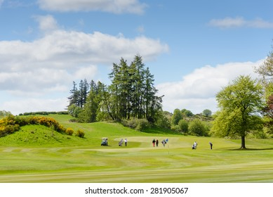 """GLENEAGLES, SCOTLAND - MAY 26, 2015: golfers playing The King's Course at the Gleneagles Hotel and resort in Perthshire, Scotland.  Gleneagles was awarded  """"Best Golf Resort in the World"""" for 2014"""