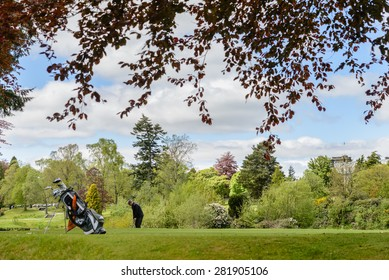 GLENEAGLES, SCOTLAND - MAY 26, 2015: golfer practising at the Gleneagles Hotel and leisure resort in Perthshire, Scotland.  Gleneagles was the venue for the 2014 Ryder Cup, won by the European team.