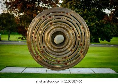 GLENEAGLES, SCOTLAND - OCTOBER 03, 2016: Bronze statue to commemorate the 2014 Ryder Cup golf tournament at Gleneagles in Pershire, Scotland.
