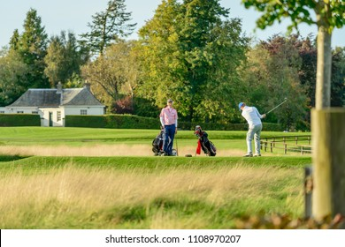 GLENEAGLES, SCOTLAND - OCTOBER 03, 2016: Two men playing a round of golf at Gleneagles Hotel in Perthshire, Scotland.