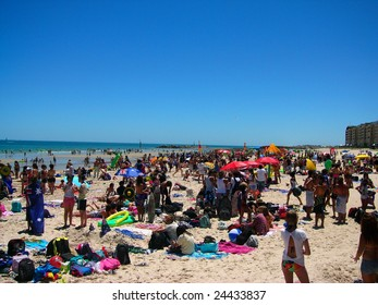 GLENELG - JANUARY 26th: Busy Glenelg beach on Australia day, with participants of the Havaianas World Record Attempt coming into shore, on January 26th 2009, Adelaide, Australia.