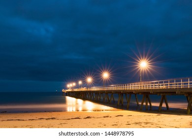 Glenelg jetty on the beach at night with lights. Adelaide, South Australia.
