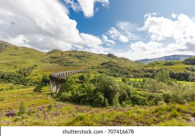 Glenfinnan historic rail viaduct in Scottish Highlands. Full frame panoramic view in sunny day