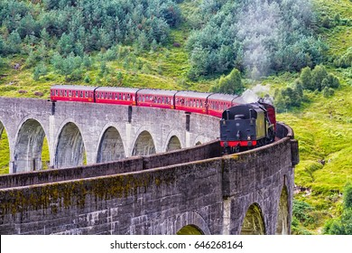Glenfinnan Railway Viaduct in Scotland with the Jacobite steam train passing over. United Kingdom