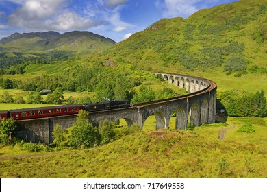 Glenfinnan Railway Viaduct in Scotland with the Jacobite steam train passing over. Scotland. United Kingdom