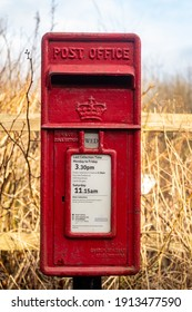 Glenlee, Scotland - December 24, 2020: Red British Royal Mail, Lamp Post office box in a rural setting