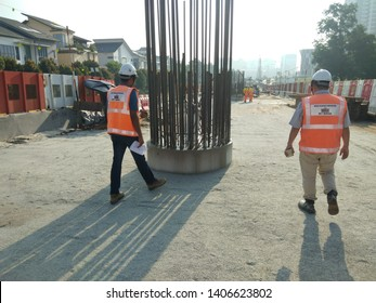 Glenmarie, Malaysia. May 20 2019. Site walk early in the morning before start work. Photo also shows the column stater rebar for column construction.