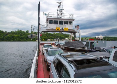 Glenora, Ontario / Canada - June 2, 2018: The Glenora Ferry transports vehicles, free of charge, from the Prince Edward County Peninsula to the mainland at Adolphustown.