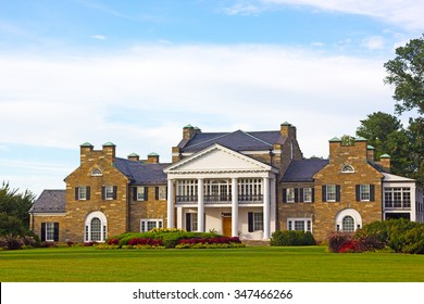 Glenview historic mansion with formal gardens at sunset. Historic Mansion at Civic Center Park in Rockville, Maryland, USA