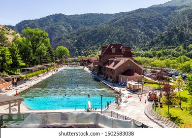 Glenwood Springs, USA - July 10, 2019: High angle view of famous Colorado hot springs pool in downtown with water and people swimming