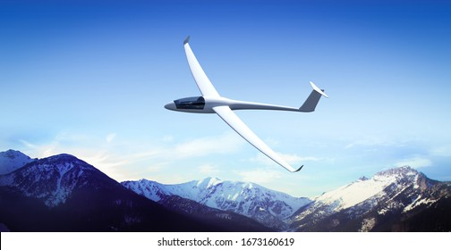 The glider is flying in the mountains