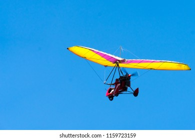 Glider high in the sky. Glider on a blue sky background.