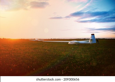 Glider ready for take off at sunset - sailplane sport & aviation photo