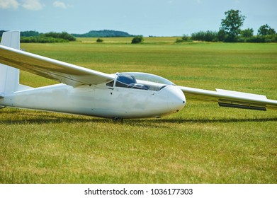 Glider or sailplane at green field