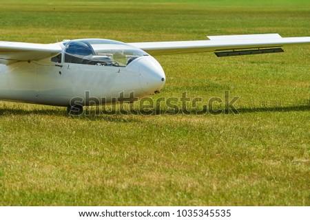 glider sailplane green field stock photo edit now 1035345535