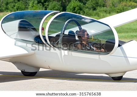 glider sailplane passenger seated cockpit waiting stock photo edit