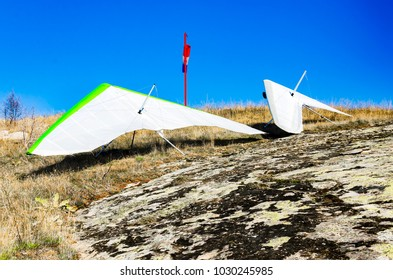 Gliders parked on mountain rock waiting appropriate wind for take off