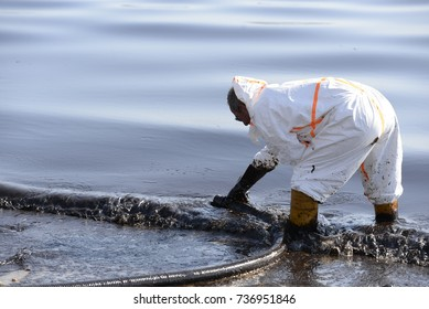 Glifada. Piraeus - Athens. Greece. -13 September 2017. Workers remove oil trying to clean beaches in Saronic Gulf  near Athens Greece. The oil leaked from the wreck of the tanker Agia Zoni 2.
