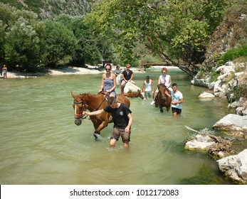 "Gliki, Thesprotia / Greece - 07/20/2017: Horse riding at the famous from greek mythology, acheron river. Acheron was known as the ""river of woe"", and was one of the five rivers of the Greek underworld"