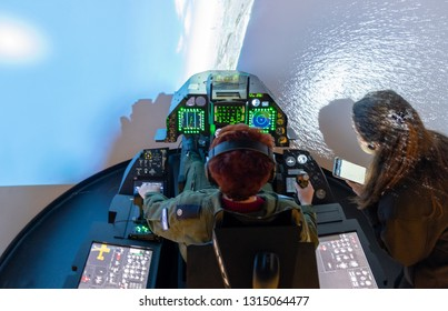 GLILOT, ISRAEL - JANUARY 5, 2019: Undefined person play a General Dynamics F-16 Fighting Falcon simulator