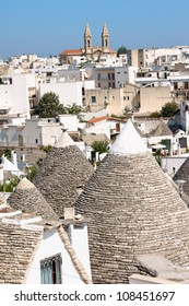 Glimpse of Alberobello, Apulia, Italy. Alberobello was founded in the 15th century on land that was originally in oak forest in the province of Bari.