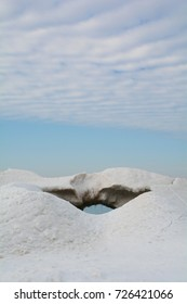 A glimpse of Lake Michigan through an ice formation on a sunny, winter afternoon.