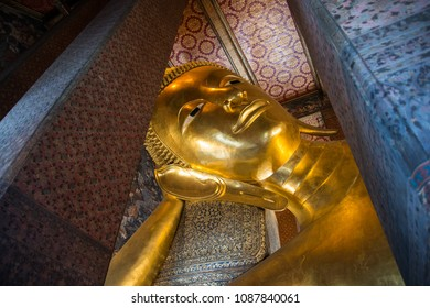 A glimsp of the Reclining Buddha at Temple of Dawn or Wat Pho, Thailand.
