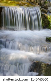 Glistening cascading flow of fresh stream in late afternoon, suitable for an ecological or nature campaign