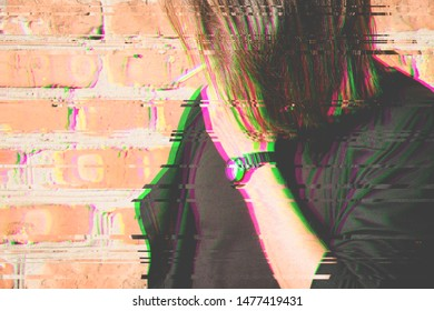 Glitch effect witht pink and green colors . A young man with a cigarette near a bricks wall. Glitch effect. Trend effect.