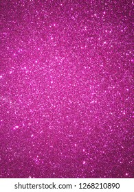 Glitter background with shiny sparkles and magenta colors. Vector