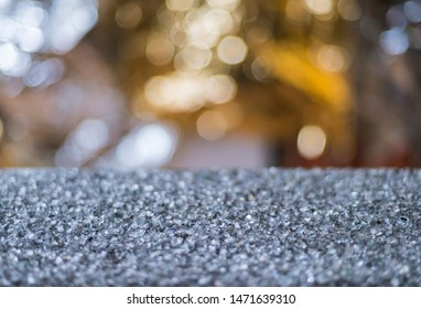 Glitter background. Simple beautiful shining background. Table with glass splitter and beautiful luminous wall.