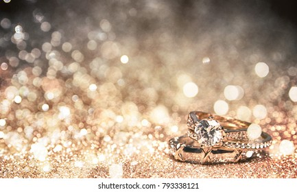 Glitter background with wedding rings