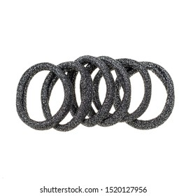A lot of glitter black hair ties bands. colorful Scrunchies isolated on white background